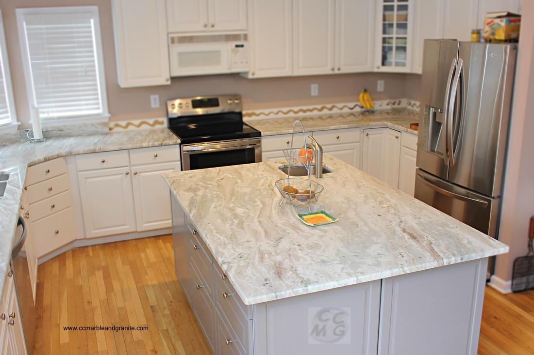 Countertops are fantasy brown granite the backsplash is marble - Copenhagen Granite Brown Fantasy Quartzite